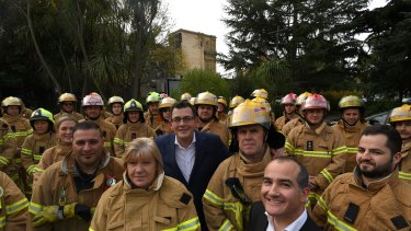 Voluntary and paid CFA members with Premier Daniel Andrews and Emergency Services Minister James Merlino in June.