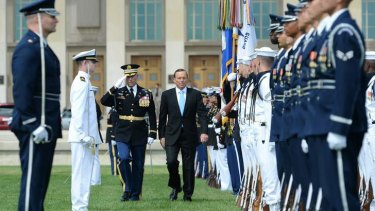 Prime Minister Tony Abbott receives full honours on his arrival at the Pentagon to meet Secretary of Defence Chuck Hagel
