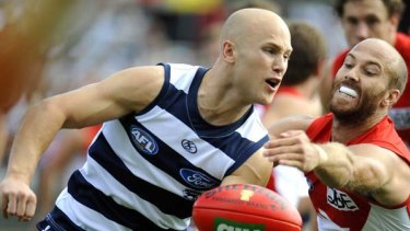 Geelong's Gary Ablett evading Sydney's Jarrad McVeigh in a best-on-ground performance in Geelong?s demolition of the Swans yesterday.