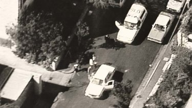Ambush: Officers at the scene in Walsh Street, South Yarra, where policemen Damian Eyre and Steven Tynan were killed on October 12, 1988.
