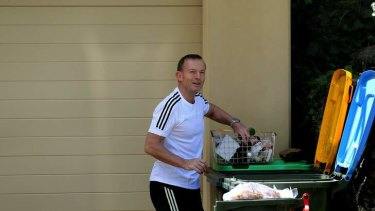 """""""It's always a beautiful morning in Forestville"""": Prime Minister Tony Abbott talks with Fairfax reporters as he sorts his recycling."""