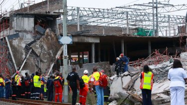 Rescuers search for  workers under the rubble at the Tongaat Mall, 40 kilometres north of Durban.