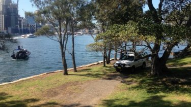 Police at  Illoura Reserve, Balmain East, after a woman's body was found in the water.