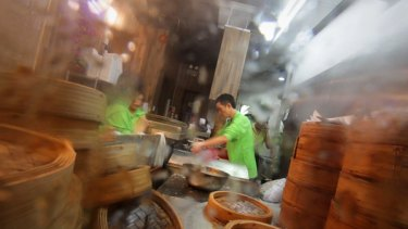 A busy chef at Hong Kong's small and steamy Tim Ho Wan restaurant.