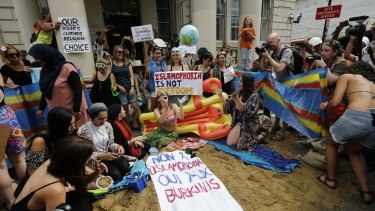 Activists protest the burkini ban outside the French embassy in London.