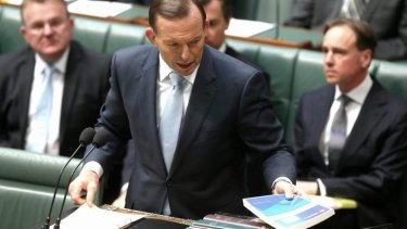 Prime Minister Tony Abbott tables in Parliament the royal commission's report on the Rudd government's home insulation scheme.