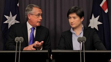 Deputy Prime Minister and Treasurer Wayne Swan and Finance minister Senator Penny Wong.