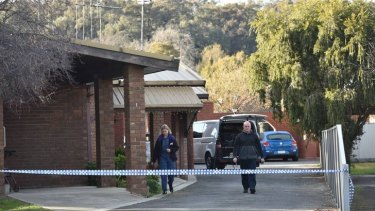 Forensics investigate the scene where a woman was found dead in the Bendigo suburb of Kennington.