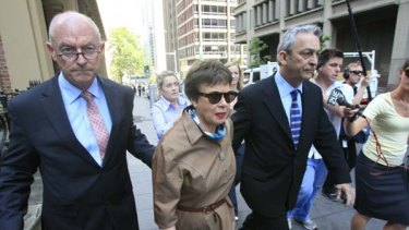 Shirley Justins leaves court after receiving 22 months.