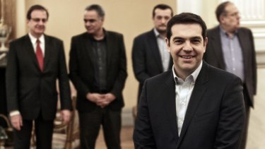 Greece's newly-appointed Prime Minister Alexis Tsipras, 40, poses before taking a secular oath at the Presidential Palace.