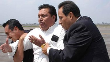 Surrender...the hijacker, a Bolivian preacher in custody.