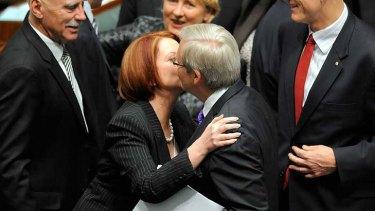 Sealed with a kiss ... Kevin Rudd congratulates Julia Gillard in parliament.
