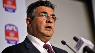 AFL CEO Andrew Demetriou releases the charges against Essendon at AFL House yesterday.