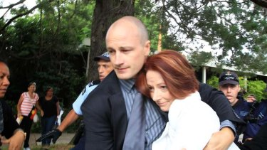 Prime Minister Julia Gillard and a member of her Close Personal Protection Team, Lucas.