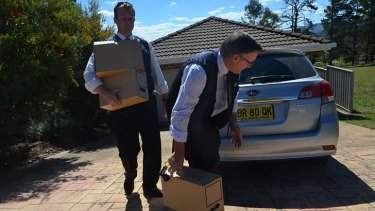 ICAC raid: Investigators at Mr Torbay's home.