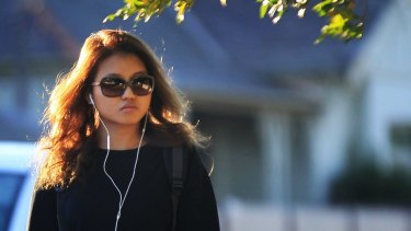Christine Jia Xin Lee leaves Ryde police station in Sydney.