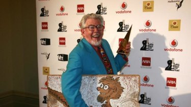 Stripped of award ... Rolf Harris with his ARIA award in 2008.