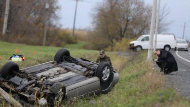 Suspicous car: Police investigate an overturned vehicle in Saint-Jean-sur-Richelieu, Quebec.