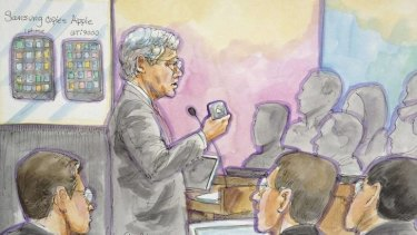 Apple attorney Harold McElhinny, centre, delivers his opening statement in a high profile trial between Samsung and Apple in San Jose, California.