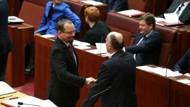 Motoring Enthusiast Party Senator Ricky Muir is congratulated by Senate government leader Senator Eric Abetz.