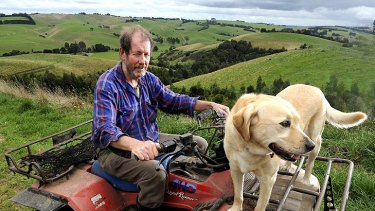 Feeling undermined: Phil Piper, and dog Floss, on land that could become a coalmine.