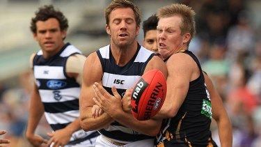 Jack Riewoldt, who kicked four goals for the Tigers, collides with Geelong's Joel Corey.