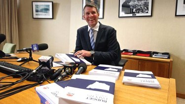 NSW Treasurer, Mike Baird: his budget is expected to allocate the $1.8 billion across four years.