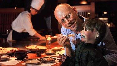 David Strassman feeds Chuck at Japanese Teppanyaki Inn on Collins Street.