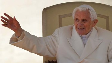 Poignant … Pope Benedict waves from the altar during his final general audience. He spoke of ''stormy waters'' but said God would not let the Church ''sink''.