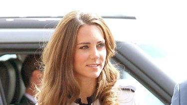 Royal navy blue ... Kate Middleton makes a virtue of the vice-regal look.