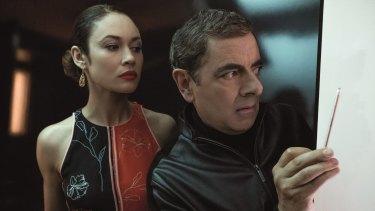 Olga Kurylenko as Ophelia and Rowan Atkinson as Johnny English.