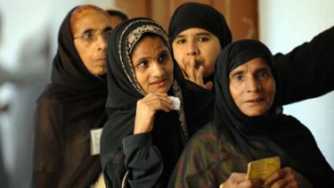 Off to the polls...Indian Muslim women wait in line to cast their vote in Varanasi