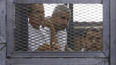 Peter Greste, Mohammed Fahmy and Baher Mohamed during their trial.