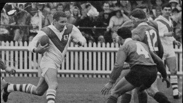 Graeme Langlands braces himself as he makes from full-back on September 9, 1967.