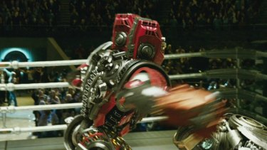 Duck & cover: one robot takes a swing at another robot in the robot boxing movie <i>Real Steel</i>. The film also features non-robot characters played by Hugh Jackman and Hope Davis.