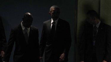 Barack Obama arrives to speak at the Millennium Development Goals Summit at the UN.