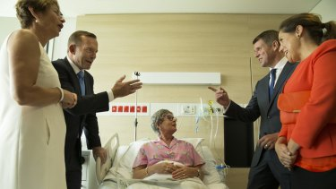 Mike Baird, right, with his wife Kerryn and Tony Abbott, left, with his wife Margie visit breast cancer patient Lyn Marvey at the Chris O'Brien Lifehouse Hospital in February.