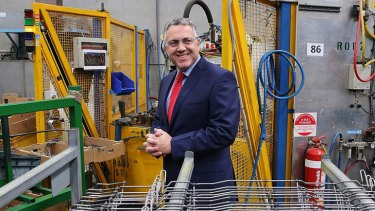 Out for the count: Shadow Treasurer Joe Hockey at a manufacturing facility in Adelaide this week.