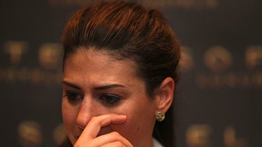 Stephanie Rice wipes a tear away at her press conference.