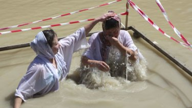 Orthodox Christian pilgrims at the section of the Jordan River where Jesus Christ is said to have been baptised.