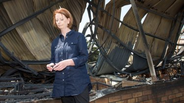Prime Minister Julia Gillard inspects the ruins of  Dunalley Primary School in Tasmania, where bushfires have destroyed about 100 buildings.