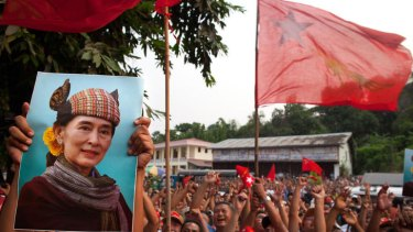 National League for Democracy (NLD) supporters hold up a picture of Aung San Suu Kyi while celebrating their victory in Burma's parliamentary elections.