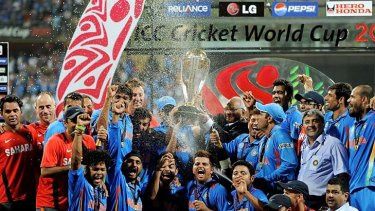 Indian cricketers celebrate after beating Sri Lanka by six wickets.