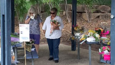 The suspect's mother and aunt at Kurilpa Park on Tuesday.