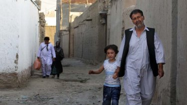 Left: Shir Ahmad in Kabul with his daughter Sadaf, 6. His son has left Afghanistan, never to return.