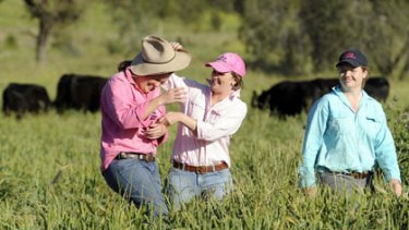 Cropping it sweet ... Anna, Emma and Eliza Redden, in the paddock of their Somerton property where they run the Triple A Angus Stud.