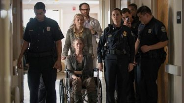 Carol (Melissa McBride) and Dawn (Christine Woods) at the prisoner exchange during the mid-season finale of <i>The Walking Dead</i> season five.