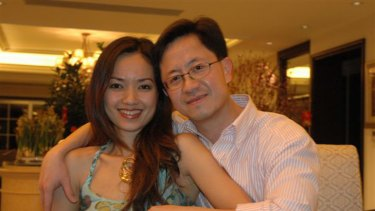 Jailed businessman Matthew Ng, pictured with his wife Niki Chow, broke down in a Chinese court yesterday.