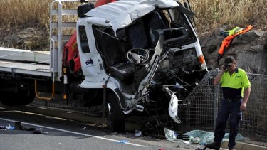 Man trapped after two trucks crash on Monaro Highway