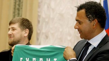 Chechen President Ramzan Kadyrov hands Ruud Gullit his team's jersey. It would prove a poisoned chalice.